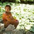 Resting by the pond with lilies — Stock Photo #5631126