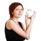 Woman holding piggy bank against white background — Stock Photo