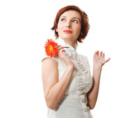 Beautiful woman with flower gerbera in her hands against white b — Stock Photo