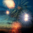 Brightly colorful fireworks in the night sky — Stock Photo #5913374