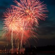 Brightly colorful fireworks in the night sky — Stock Photo