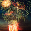 Brightly colorful fireworks in the night sky — Stock Photo #5913477