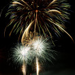 Brightly colorful fireworks in the night sky — Stock Photo #5914093