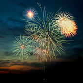 Brightly colorful fireworks in the night sky — Foto Stock