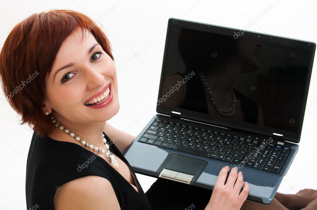 Attractive young woman using laptop computer against white background — Stock Photo #6190460
