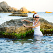 Stock Photo: Beautiful woman splashing in the sea