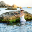 Beautiful woman splashing in the sea — Stock Photo