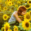 Stock Photo: Woman on blooming sunflower field