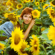Woman on blooming sunflower field — Stock Photo #6424199
