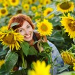 Woman on blooming sunflower field — Stock Photo #6424226