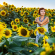 Woman on blooming sunflower field — Stock Photo #6432516