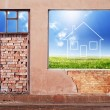 Wall with hole revealing home symbol on landscape — Stock Photo