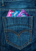 Condom in jeans pocket — Stock Photo