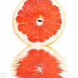 Fresh grapefruit over white — Stock Photo