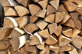 Fire wood lies in a woodpile — Stock Photo