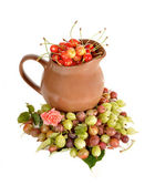 Jug with a sweet cherry among berries — Stock Photo