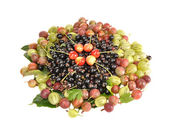 Gooseberry, currant and sweet cherry on a table — Stock Photo