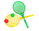 Multi-colored balls on rackets — Stock Photo