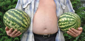 Two water-melons in man's hands — Stock Photo