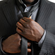 Business man fixing his tie — Stock Photo #5560788