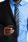 Zakenman met behulp van mobiele telefoon — Stockfoto