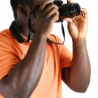 Stock Photo: Student photographer taking a picture with camera