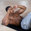 African american doing sit ups and crunches — Stock Photo #5576139