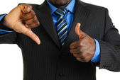 Business man showing thumbs up and thumbs down — Stock Photo