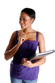 Young female student holding pencil and book — Stock Photo