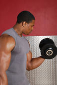 African american lifting weights — Stock Photo