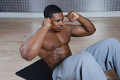 African american doing sit ups and crunches — Stock Photo