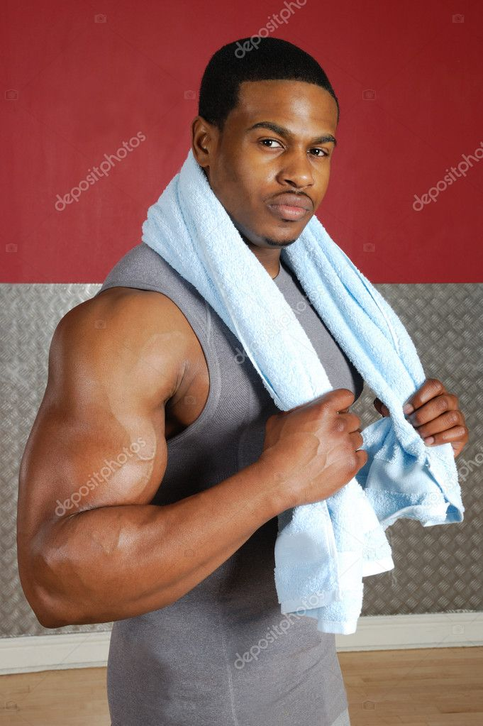 This is an image of a fitness trainer holding towel. — Stock Photo #5575779