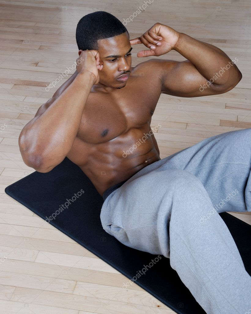 This is an image of a man performing sit ups. — Stock Photo #5575808