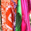 African dresses colored on a market for the sale - Stock Photo