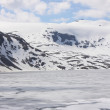 Frozen lake and snowy mountains in norway - ストック写真