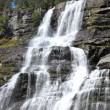 Big waterfall in a fjord it norvege in spring — Stock Photo