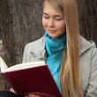 Girl reading a book - Stock Photo