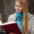 Girl reading book — Stock Photo #5433452