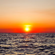 Stock Photo: Sunset over sea
