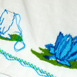 Unfinished embroidered serviette — Stock Photo