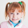 Smiling little girl with milk teeth — Stockfoto