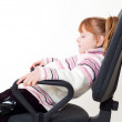 Little girl sleepping in a chair — Stock Photo