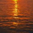 Sunset in ripple water — Stock Photo