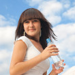 Girl with bottle — Stock Photo
