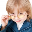 Little girl in glasses - Stock Photo