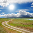 Sun over dirty road - Stock Photo