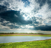 View to overcast landscape with pond — Stock Photo