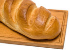 Bread on breadboard — Stock Photo