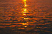 Sunset in ripple water — Stock Photo