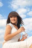 Girl with bottle — Stock Photo
